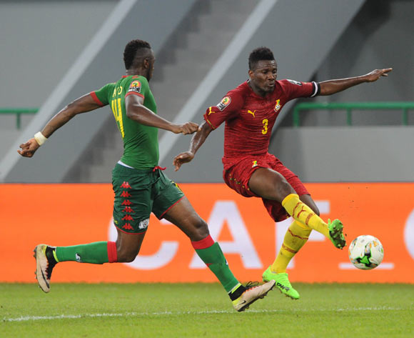 Asamoah Gyan of Ghana is challenged by Issoufou Dayo of Burkina Faso during the 2017 Africa Cup of Nations Finals 3&4 match playoff between Burkina Faso and Ghana at the Port Gentil  in Gabon on 04 February 2017 ©Sydney Mahlangu/BackpagePix