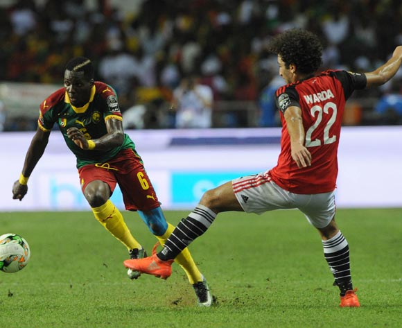 Ambroise Oyongo of Cameroon is tackled by Amr Warda of Egypt  during the 2017 Africa Cup of Nations Finals, Afcon Final match between Egypt and Cameroon at the Libreville  in Gabon on 05 February 2017 ©Sydney Mahlangu/BackpagePix