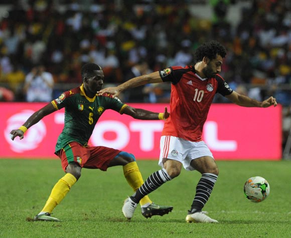 Mohamed Salah of Egypt is challenged by Ambroise Oyongo of Cameroon during the 2017 Africa Cup of Nations Finals, Afcon Final match between Egypt and Cameroon at the Libreville  in Gabon on 05 February 2017 ©Sydney Mahlangu/BackpagePix