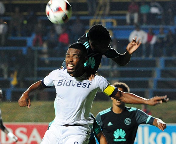 Thulani Hlatshwayo of Bidvest Wits  challenged Mosa Lebusa of Ajax Cape Town during the Absa Premiership 2016/17 match between Bidvest Wits and Ajax Cape Town at Bidvest Stadium on 07 February 2017 ©Aubrey Kgakatsi/BackpagePix