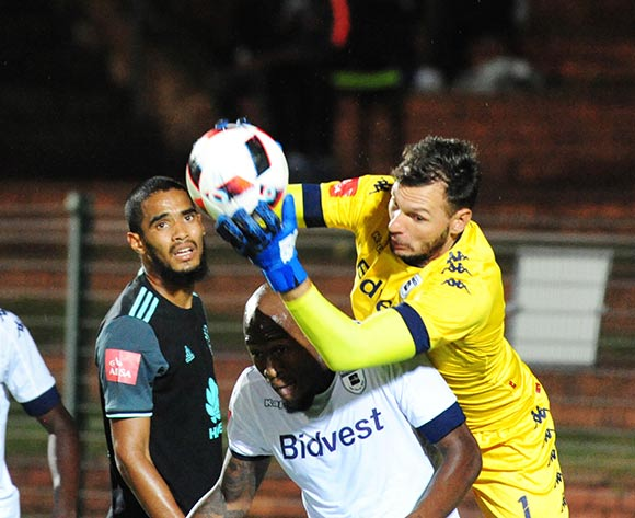 Darren Keet of Bidvest Wits collects a ball over Sfiso Hlanti of Bidvest Wits during the Absa Premiership 2016/17 match between Bidvest Wits and Ajax Cape Town at Bidvest Stadium on 07 February 2017 ©Aubrey Kgakatsi/BackpagePix