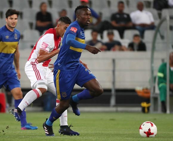 Sibusiso Masina of Cape Town City FC evades challenge from Travis Graham of Ajax Cape Town during the Absa Premiership 2016/17 football match between Ajax Cape Town and Cape Town City FC at Cape Town Stadium, Cape Town on 11 February 2017 ©Chris Ricco/BackpagePix