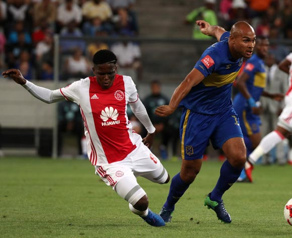 Ndiviwe Mdabuka of Ajax Cape Town evades challenge from Robyn Johannes of Cape Town City FC  during the Absa Premiership 2016/17 football match between Ajax Cape Town and Cape Town City FC at Cape Town Stadium, Cape Town on 11 February 2017 ©Chris Ricco/BackpagePix