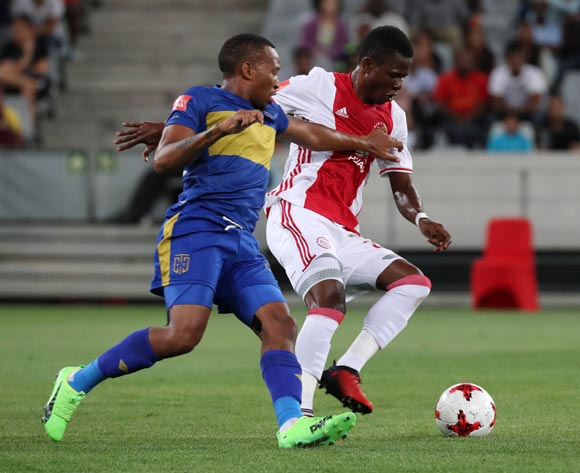 Rodrick Kabwe of Ajax Cape Town evades challenge from Lehlohonolo Majoro of Cape Town City FC during the Absa Premiership 2016/17 football match between Ajax Cape Town and Cape Town City FC at Cape Town Stadium, Cape Town on 11 February 2017 ©Chris Ricco/BackpagePix