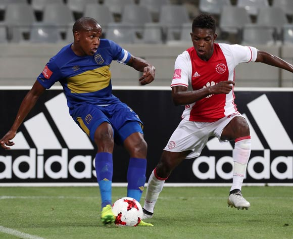 Lebogang Manyama of Cape Town City FC evades challenge from Lawrence Lartey of Ajax Cape Town during the Absa Premiership 2016/17 football match between Ajax Cape Town and Cape Town City FC at Cape Town Stadium, Cape Town on 11 February 2017 ©Chris Ricco/BackpagePix
