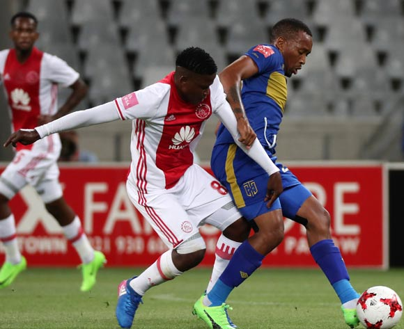 Lehlohonolo Majoro of Cape Town City FC evades challenge from Ndiviwe Mdabuka of Ajax Cape Town during the Absa Premiership 2016/17 football match between Ajax Cape Town and Cape Town City FC at Cape Town Stadium, Cape Town on 11 February 2017 ©Chris Ricco/BackpagePix