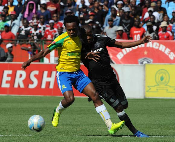Percy Tau of Mamelodi Sundowns is challenged by Thabo Matlaba of Orlando Pirates during theAbsa Premiership match between Mamelodi Sundowns and Orlando Pirates at the Loftus Stadium on 11 February 2017 ©Sydney Mahlangu/BackpagePix