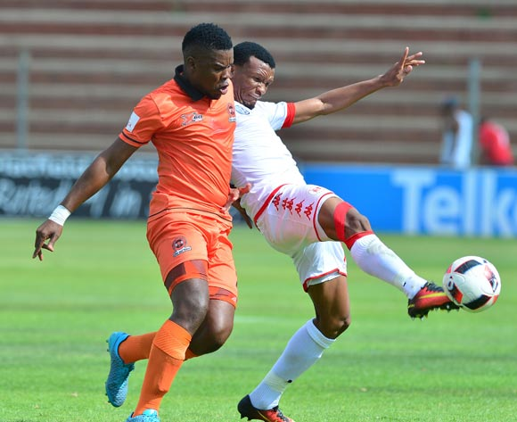 Mothobi Mvala of Highlands Park challenged by Tshepo Tema of Polokwane City during the Absa Premiership 2016/17 match between Highlands Park and Polokwane City at Makhulong Stadium, Johannesburg South Africa on 12 February 2017 ©Samuel Shivambu/BackpagePix