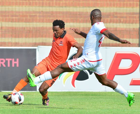 Tlou Segolela of Polokwane City challenged by Franklin Cale of Highlands Park during the Absa Premiership 2016/17 match between Highlands Park and Polokwane City at Makhulong Stadium, Johannesburg South Africa on 12 February 2017 ©Samuel Shivambu/BackpagePix
