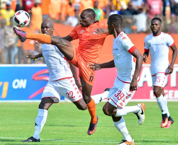 Rodney Ramagalela (c) of Polokwane City challenged by Zamuxolo Ngalo (l) and Chris Katjiukua (r) of Highlands Park during the Absa Premiership 2016/17 match between Highlands Park and Polokwane City at Makhulong Stadium, Johannesburg South Africa on 12 February 2017 ©Samuel Shivambu/BackpagePix