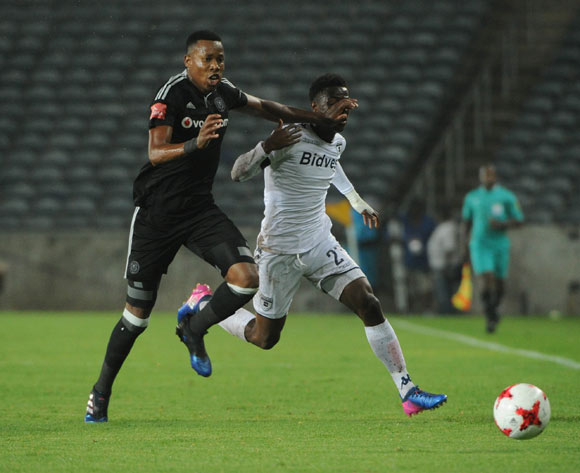 Phakamani Mahlambi is tackled by Happy Jele of Orlando Pirates during the Absa Premiership match between Orlando Pirates and Bidvest Wits on 15 February 2017 at Orlando Stadium ©Sydney Mahlangu/BackpagePix