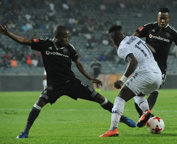 Gabadinho Mhango of Bidvest Wits dribbles past Thabo Matlaba of Orlando Pirates (l) and Happy Jele of Orlando Pirates during the Absa Premiership match between Orlando Pirates and Bidvest Wits on 15 February 2017 at Orlando Stadium ©Sydney Mahlangu/BackpagePix