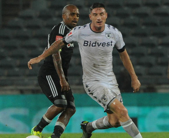 James Keene of Bidvest Wits challenges Oupa Manyisa  of Orlando Pirates during the Absa Premiership match between Orlando Pirates and Bidvest Wits on 15 February 2017 at Orlando Stadium ©Sydney Mahlangu/BackpagePix