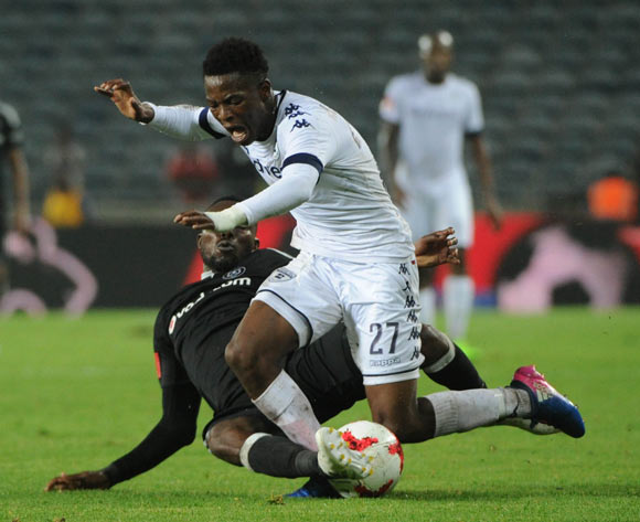 Phakamani Mahlambi of Bidvest Wits is tackled by Dove Wome of Orlando Pirates during the Absa Premiership match between Orlando Pirates and Bidvest Wits on 15 February 2017 at Orlando Stadium ©Sydney Mahlangu/BackpagePix