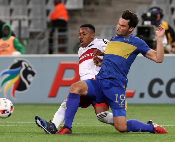 Roland Putsche of Cape Town City FC tackled by Happy Jele of Orlando Pirates during the Absa Premiership 2016/17 football match between Cape Town City FC and Orlando Pirates at Cape Town Stadium, Cape Town on 18 February 2017 ©Chris Ricco/BackpagePix