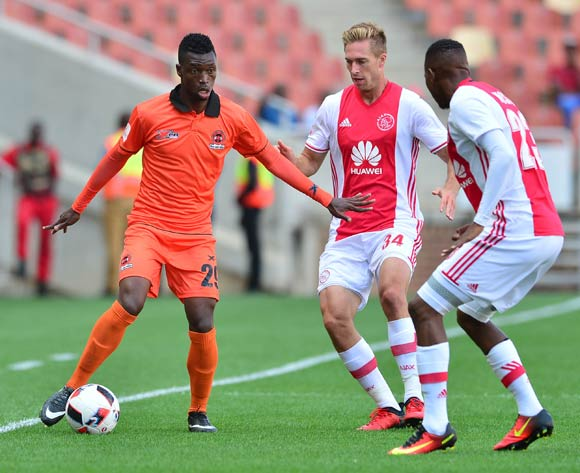 Walter Musona of Polokwane City challenged by Rheece Evans of Ajax Cape Town during the Absa Premiership 2016/17 match between Polokwane City and Ajax Cape Town at Peter Mokaba Stadium, Polokwane South Africa on 18 February 2017 ©Samuel Shivambu/BackpagePix