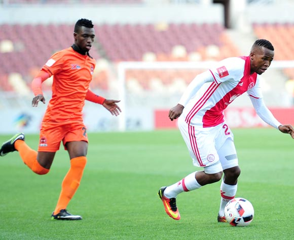 Thabo Mosadi of Ajax Cape Town challenged by Walter Musona of Polokwane City during the Absa Premiership 2016/17 match between Polokwane City and Ajax Cape Town at Peter Mokaba Stadium, Polokwane South Africa on 18 February 2017 ©Samuel Shivambu/BackpagePix