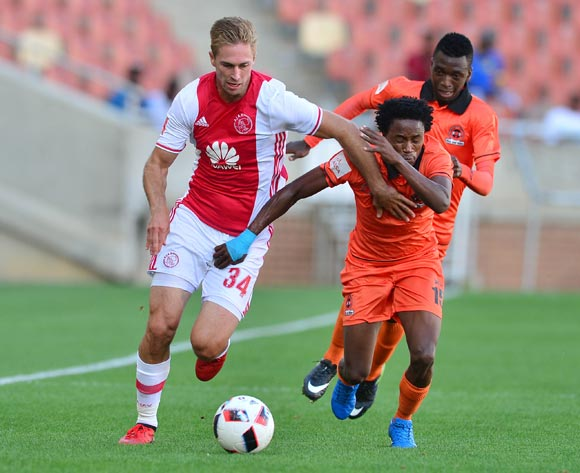 Rheece Evans of Ajax Cape Town challenged by Thabang Klass of Polokwane City during the Absa Premiership 2016/17 match between Polokwane City and Ajax Cape Town at Peter Mokaba Stadium, Polokwane South Africa on 18 February 2017 ©Samuel Shivambu/BackpagePix
