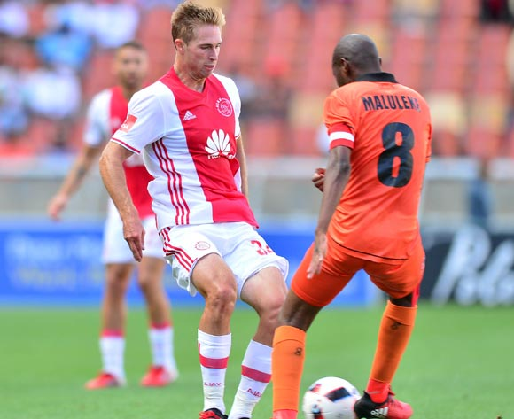 Rheece Evans of Ajax Cape Town challenged by Jabulani Maluleke of Polokwane City during the Absa Premiership 2016/17 match between Polokwane City and Ajax Cape Town at Peter Mokaba Stadium, Polokwane South Africa on 18 February 2017 ©Samuel Shivambu/BackpagePix