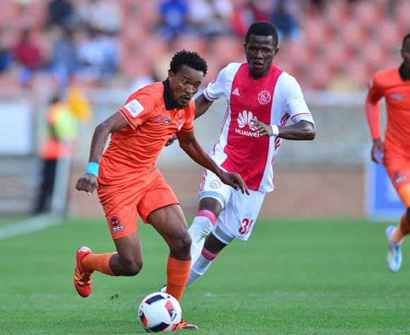 Tlou Segolela of Polokwane City challenged by Rodrick Kabwe of Ajax Cape Town during the Absa Premiership 2016/17 match between Polokwane City and Ajax Cape Town at Peter Mokaba Stadium, Polokwane South Africa on 18 February 2017 ©Samuel Shivambu/BackpagePix
