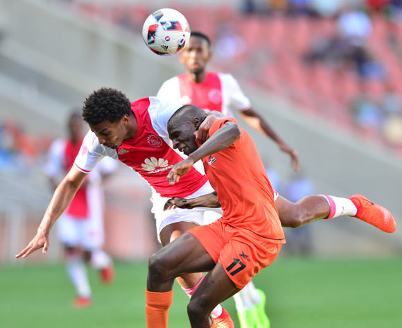 Rodney Ramagalela of Polokwane City challenged by Rivaldo Coetzee of Ajax Cape Town during the Absa Premiership 2016/17 match between Polokwane City and Ajax Cape Town at Peter Mokaba Stadium, Polokwane South Africa on 18 February 2017 ©Samuel Shivambu/BackpagePix