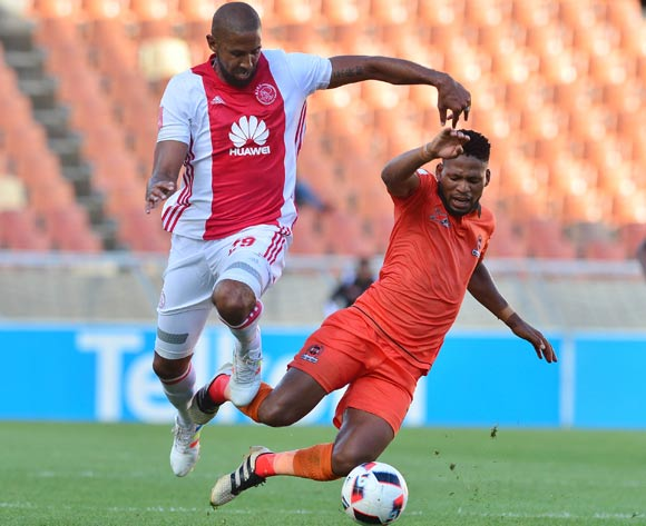 Edgar Manaka of Polokwane City challenged by Nathan Paulse of Ajax Cape Town during the Absa Premiership 2016/17 match between Polokwane City and Ajax Cape Town at Peter Mokaba Stadium, Polokwane South Africa on 18 February 2017 ©Samuel Shivambu/BackpagePix