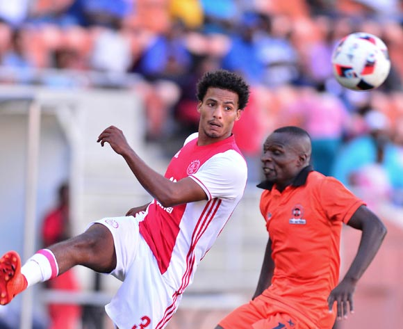 Rivaldo Coetzee of Ajax Cape Town challenged by Rodney Ramagalela of Polokwane City during the Absa Premiership 2016/17 match between Polokwane City and Ajax Cape Town at Peter Mokaba Stadium, Polokwane South Africa on 18 February 2017 ©Samuel Shivambu/BackpagePix
