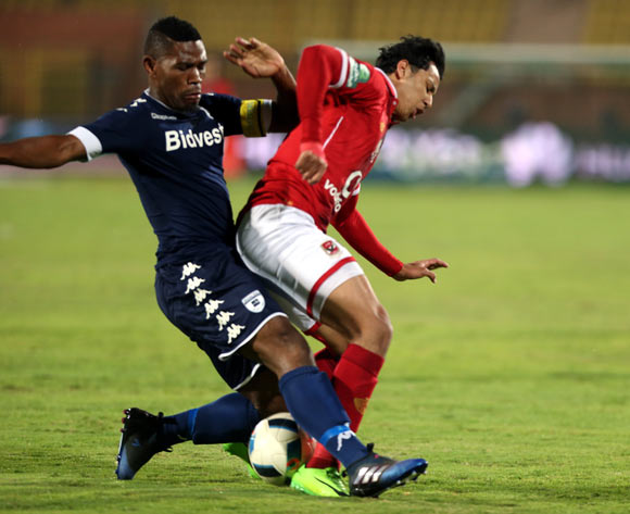 epa05842754 Al Ahly's player Amr Gamal (R)  in action  against Bidvest Wits player Thulani Hlatshwayo (L) during the African Champions League (CAF) match between Al Ahly and  Bidvest Wits   at Salam stadium in Cairo, Egypt, 11 March 2017.  EPA/KHALED ELFIQI