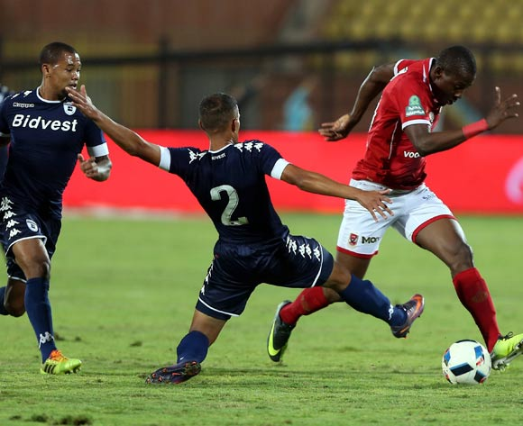 epa05842768 Al Ahly's player Agai (R) in action against Bidvest Wits player Nazeer Allie (C), Wangu Gome (L) during the African Champions League (CAF) match between Al Ahly and  Bidvest Wits   at Salam stadium in Cairo, Egypt, 11 March 2017.  EPA/KHALED ELFIQI