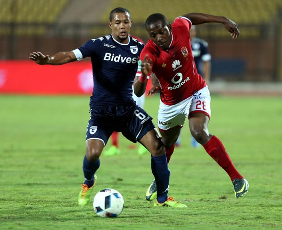 epa05842769 Al Ahly's player Junior Ajayi (R)  in action  against Bidvest Wits player Wangu Gome (L) during the African Champions League (CAF) match between Al Ahly and  Bidvest Wits   at Salam stadium in Cairo, Egypt, 11 March 2017.  EPA/KHALED ELFIQI
