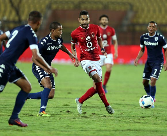 epa05842800 Al Ahly's player Moamen Zakaria (R) in action  against Bidvest Wits player Nazeer Allie (L) Wangu Gome (C) during the African Champions League (CAF) match between Al Ahly and  Bidvest Wits at Salam stadium in Cairo, Egypt, 11 March 2017.  EPA/KHALED ELFIQI