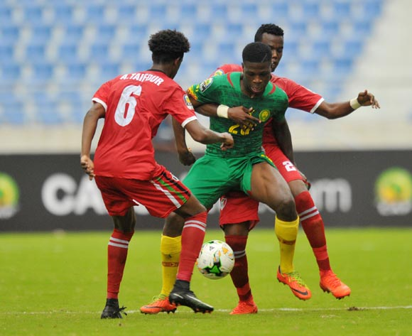 Kevin Soni of Cameroon challenged by Ammar Taifour and Baghdad Ibrahim Salih of Sudan during the 2017 Total Zambia U-20 African Cup of Nations match between Sudan and Cameroon at Levy Mwanawasa Stadium, Ndola Zambia on 02 March 2017 ©Muzi Ntombela/BackpagePix