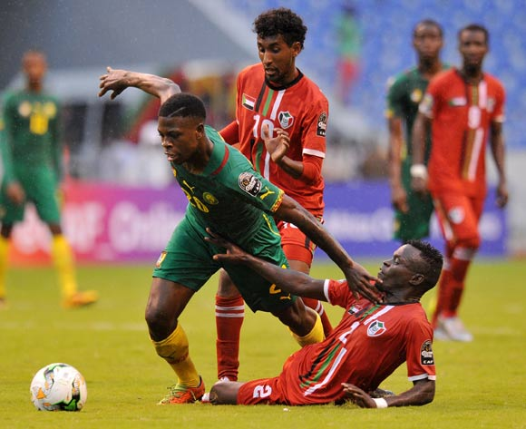 Kevin Soni of Cameroon challenged by Hassan Hassan and Baghdad Salih of Sudan during the 2017 Total Zambia U-20 African Cup of Nations match between Sudan and Cameroon at Levy Mwanawasa Stadium, Ndola Zambia on 02 March 2017 ©Muzi Ntombela/BackpagePix