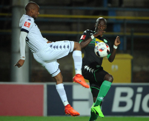 Xola Mlambo of Bidvest Wits clears the ball ahead of Musa Nyatama of Bloemfontein Celtic during the Absa Premiership match between Bidvest Wits and Bloemfontein Celtic  on the 03 March 2017 at Bidvest Stadium © Sydney Mahlangu/BackpagePix