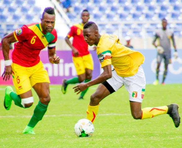 Mohamed Dide Fofana of Guinea beats Mali defender/BackpagePix