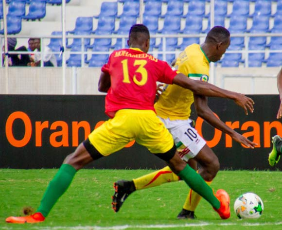 Mali's Ibrahima Kone (10) being policed by two Guinea players, Mohamed Aly Camara and Mohamed Camara (5)