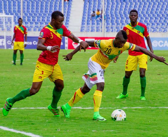 Mali's Sekou Koita (20) beats Mamadouba Diaby of Guinea to the ball