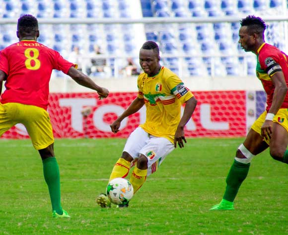 Mali's Sidiki Maiga on ball watched by Guinea's Ibrahima Sory Soumah and captain Mohamed Dide Fofana