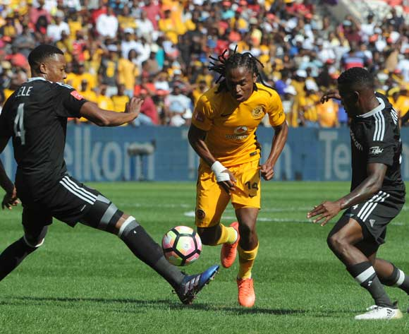 Siphiwe Tshabalala of Kaizer Chiefs dribbles past Happy Jele of Orlando Pirates (l) and Ntsikelelo Nyauza of Orlando Pirates during theAbsa Premiership match between Kaizer Chiefs and Orlando Pirates  on the 04 March 2017 at FNB Stadium © Sydney Mahlangu/BackpagePix