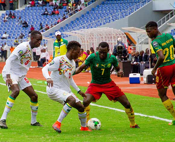 Ketu Jih Kalvin of Cameroon fights for the ball against Jean Jacques Ndecky of Senegal during the 2017 Total Zambia U-20 African Cup of Nations match between Senegal and Cameroon at Levy Mwanawasa,Ndola,Zambia on 05 March 2017 ©Muzi Ntombela/BackpagePix