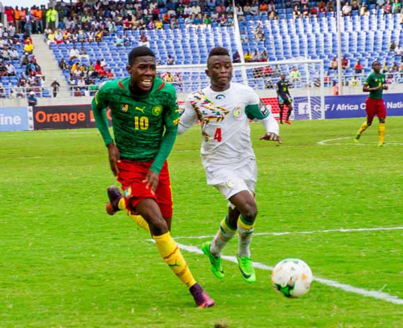 Victor Syvestre Mpindi Ekani of Cameroon tries to beat Souleymane Aw of Senegal during the 2017 Total Zambia U-20 African Cup of Nations match between Senegal and Cameroon at Levy Mwanawasa,Ndola,Zambia on 05 March 2017 ©Muzi Ntombela/BackpagePix
