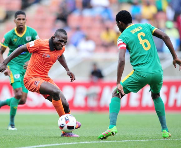Rodney Ramagalela of Polokwane City challenged by Dineo Shaku of Baroka FC during the Absa Premiership 2016/17 match between Polokwane City and Baroka FC at Peter Mokaba Stadium, South Africa on 04 March 2017 ©Samuel Shivambu/BackpagePix