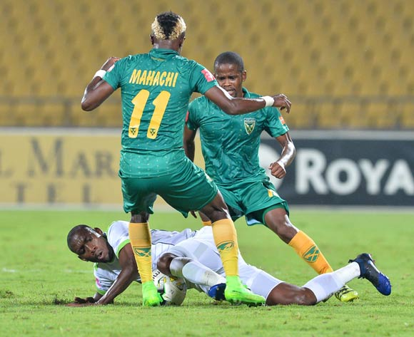 Tintswalo Tshabalala of Platinum Stars challenged by Kudakwashe Mahachi of Golden Arrows during the Absa Premiership 2016/17 match between Platinum Stars and Golden Arrows at Royal Bafokeng Stadium, South Africa on 07 March 2017 ©Samuel Shivambu/BackpagePix