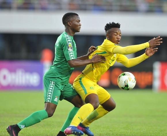 Khanyiso Mayo of South Africa challenged by Solomon Sakala of Zambia during the 2017 Total Zambia U-20 African Cup of Nations Zambia match between Zambia and South Africa at Heroes National Stadium, Lusaka Zambia on 08 March 2017 ©Muzi Ntombela/BackpagePix