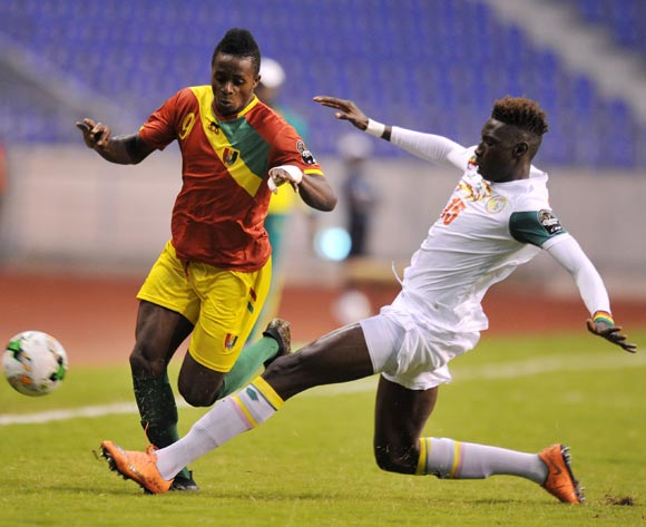 Momo Yansane of Guinea tackled by Mamadou Mbaye of Senegal during the 2017 Total Zambia U-20 African Cup of Nations Zambia match between Senegal and Guinea at Levy Mwanawasa Stadium, Lusaka Zambia on 09 March 2017 ©Muzi Ntombela/BackpagePix