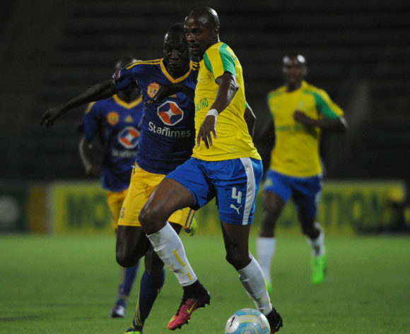 Denis Okot of Kampala City challenges Tebogo Langerman of Mamelodi Sundowns during the CAF Champions Legue match between Mamelodi Sundowns and Kampala City  on the 10 March 2017 at Lucas Moripe Stadium © Sydney Mahlangu/BackpagePix