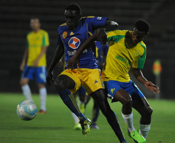 Timothy Awany of Kampala City challenges Themba Zwane of Mamelodi Sundowns during the CAF Champions Legue match between Mamelodi Sundowns and Kampala City  on the 10 March 2017 at Lucas Moripe Stadium © Sydney Mahlangu/BackpagePix