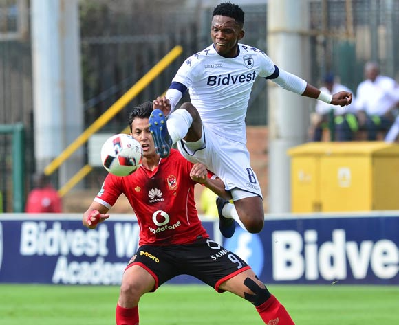 Amr Gamal of Al Ahly challenged by Thabang Monaro of Bidvets Wits during the 2017 Caf Champions League match between Bidvest Wits v Al Ahly at the Bidvest Stadium, South Africa on 19 March 2017 ©Samuel Shivambu/BackpagePix