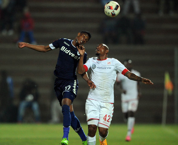 Vincent Pule of Bidvest Wits challenges Franklin Cale of Highlands Park during the Absa Premiership match between Highlands Park and Bidvest Wits  on 28 April 2017 at Makhulong Stadium ©Sydney Mahlangu /BackpagePix