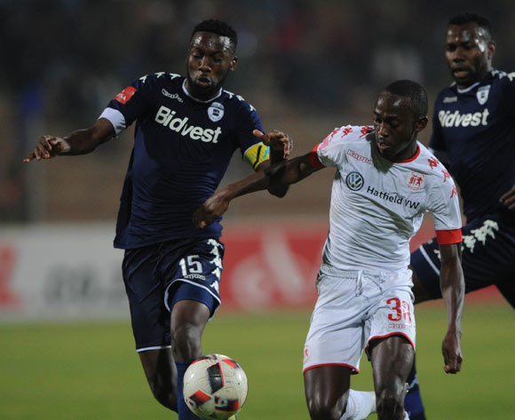 Peter Shalulile of Highlands Park is challenged by Buhle Mkhwanazi of Bidvest Wits during the Absa Premiership match between Highlands Park and Bidvest Wits  on 28 April 2017 at Makhulong Stadium ©Sydney Mahlangu /BackpagePix
